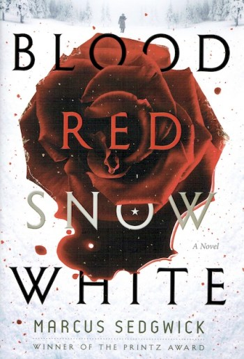 US cover of Blood Red Snow White showing red rose on snow and figure in distance.