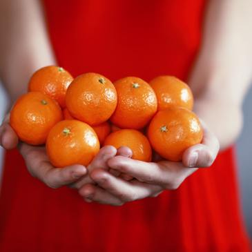 woman with oranges