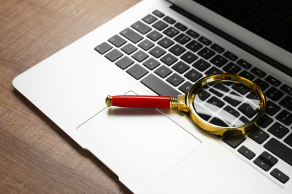 Magnifying glass on laptop