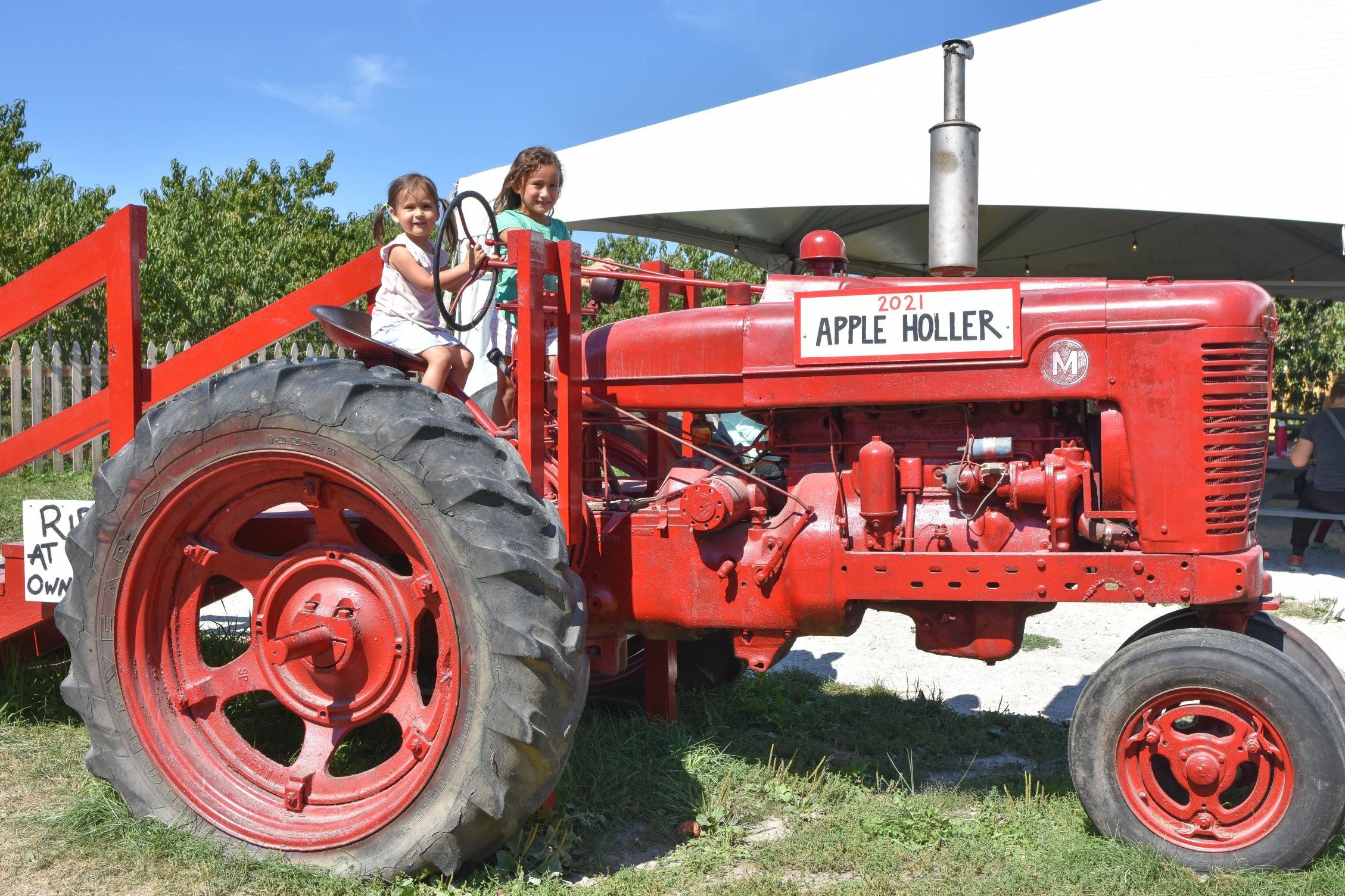 Red tractor photo opp at Apple Holler farm and orchard near Chicago
