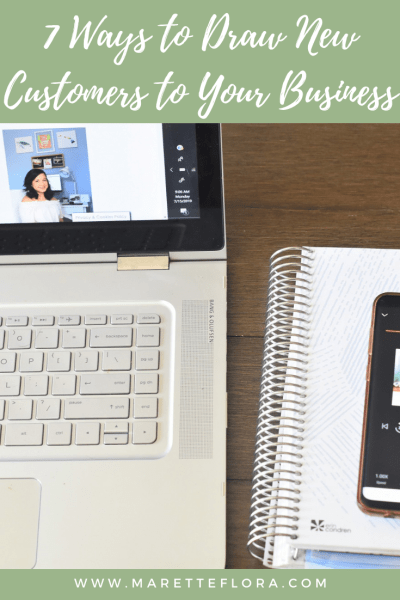 Graphic with laptop and notebook and text 7 Ways to draw new customers to your business