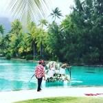 Mareva Georges rides in traditional boat in Bora Bora wedding