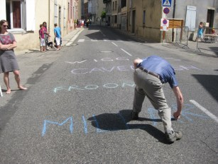 And here's Brian, chalking all the Brit names across the route. He got a huge cheer from French spectators the whole way down the street. There are more of them than seems likely from this shot.