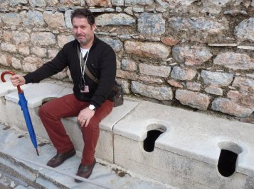 Our guide demonstrates the latrines.