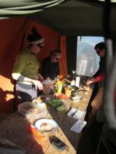 Mess tent. Kate Pauls, Margaret, Erik Gulbranson.