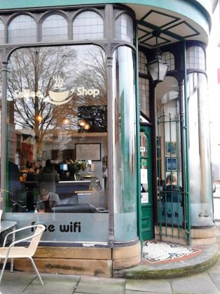 A photo of the art cafe doorway  in Art Nouveau style - inside you can see my artcafe exhibition.