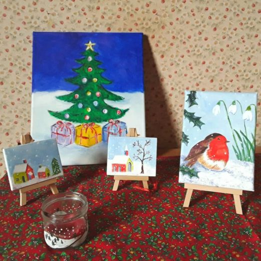 Small box canvas Christmas paintings in acrylic- Robin,  Christmas tree  and  snow covered village scenes.