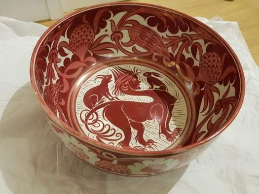Black and orange bowl with sphinx motif