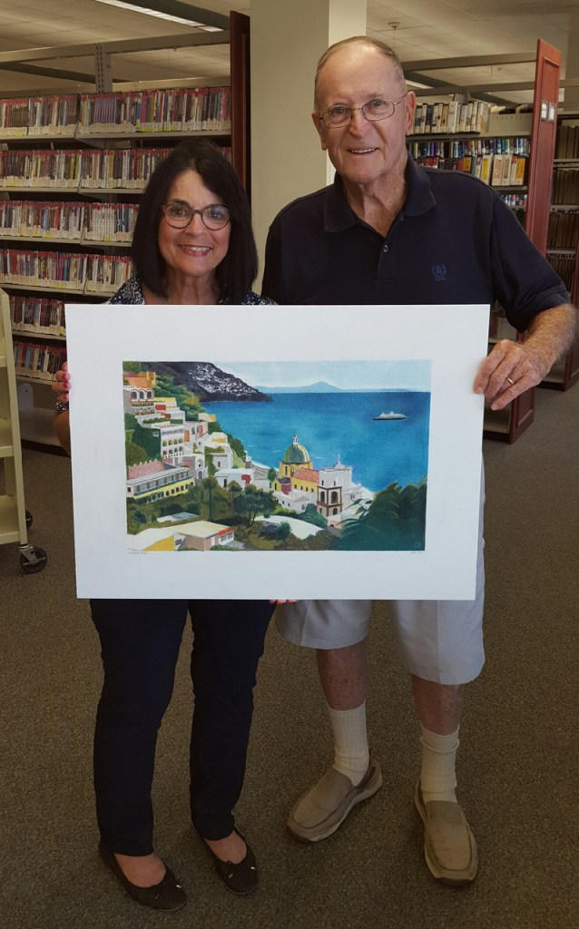 Margie Miklas and Ralph Patton with painting- Photo by Lois Patton