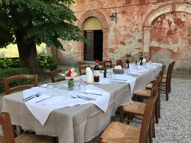 Dinner in the piazza in Tuscany Photo ny Margie Miklas