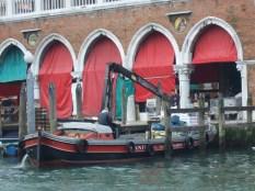 Venice men at work unloading produce at Rialto in Venice. Italy