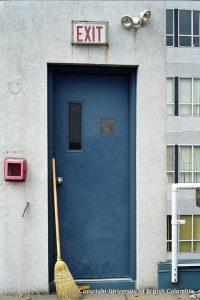 broom and blue door
