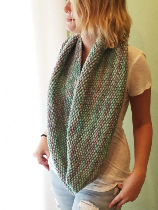 Woman wearing a seed stitch infinity scarf
