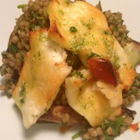 Baked halloumi with giant couscous, roasted vegetables and watercress and lime dressing