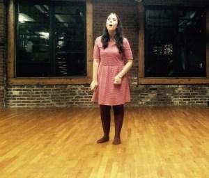 sarah singing in striped dress