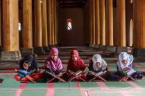 Kashmiri girls engrossed in reciting Holy Quran at the historic Jamia Masjid in Srinagar, Kashmir. Photo by : Hilal Ahmed.