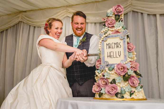 Hatty and Steven cut their epic wedding cake