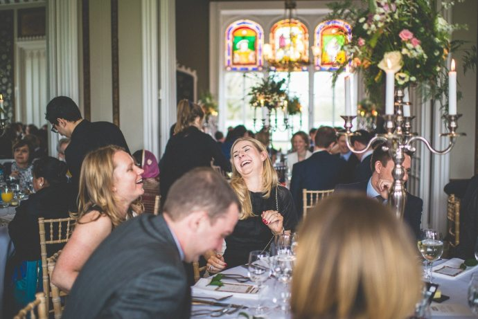 A shot of seated guests laughing together