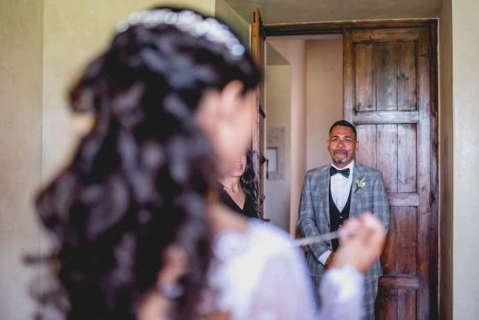 Aaysha's father wells up as he sees his daughter in her dress.