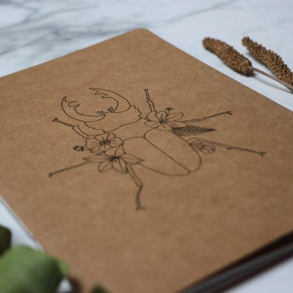 cuaderno escarabajo