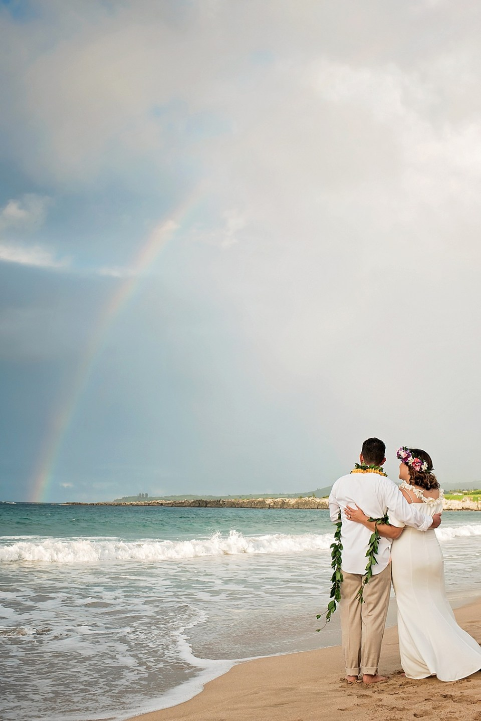 Maui wedding of Art and Suzie on pristine Ironwood Beach featuring a magnificent rainbow photographed by Mariah Milan photographers
