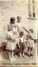 Miss Ejby with the four children. My mother at the right with her doll