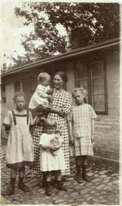 """My mother Ruth on my grandmother's arm. On the left is the """"war child"""" Lotchen from Berlin. Eva in the front and Ermegaard to the right in 1924"""