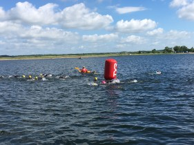 Swimmers in the water at Fulgsang lake at the Challenge Herning Triathlon 2017