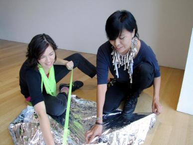 Artists handling materials. Photo Dia Felix