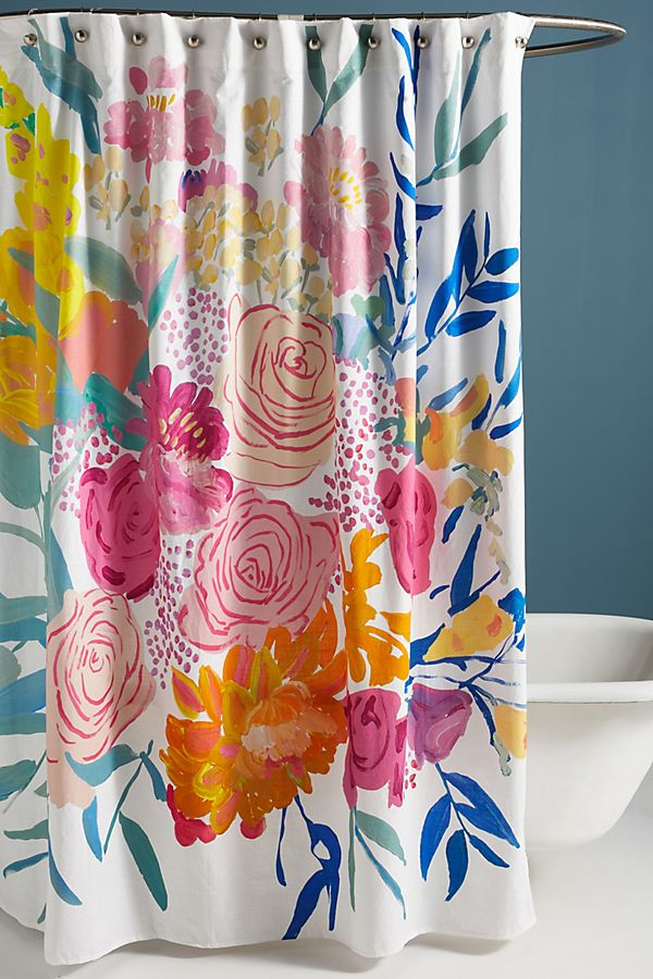 bathroom with a shower curtain before