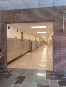 To your right, the portal to hell -- I mean, the hall to the classes. And locker doors. Many.