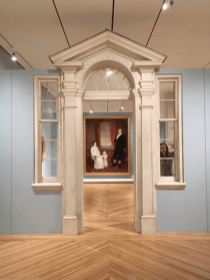 Fake door to the Kentucky Room, framing a family portrait.