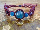 Macramé bracelet with blue and violet beads