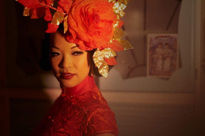 Marianne Cheesecake is modelling a Chinese peony headdress by Yuan Li.