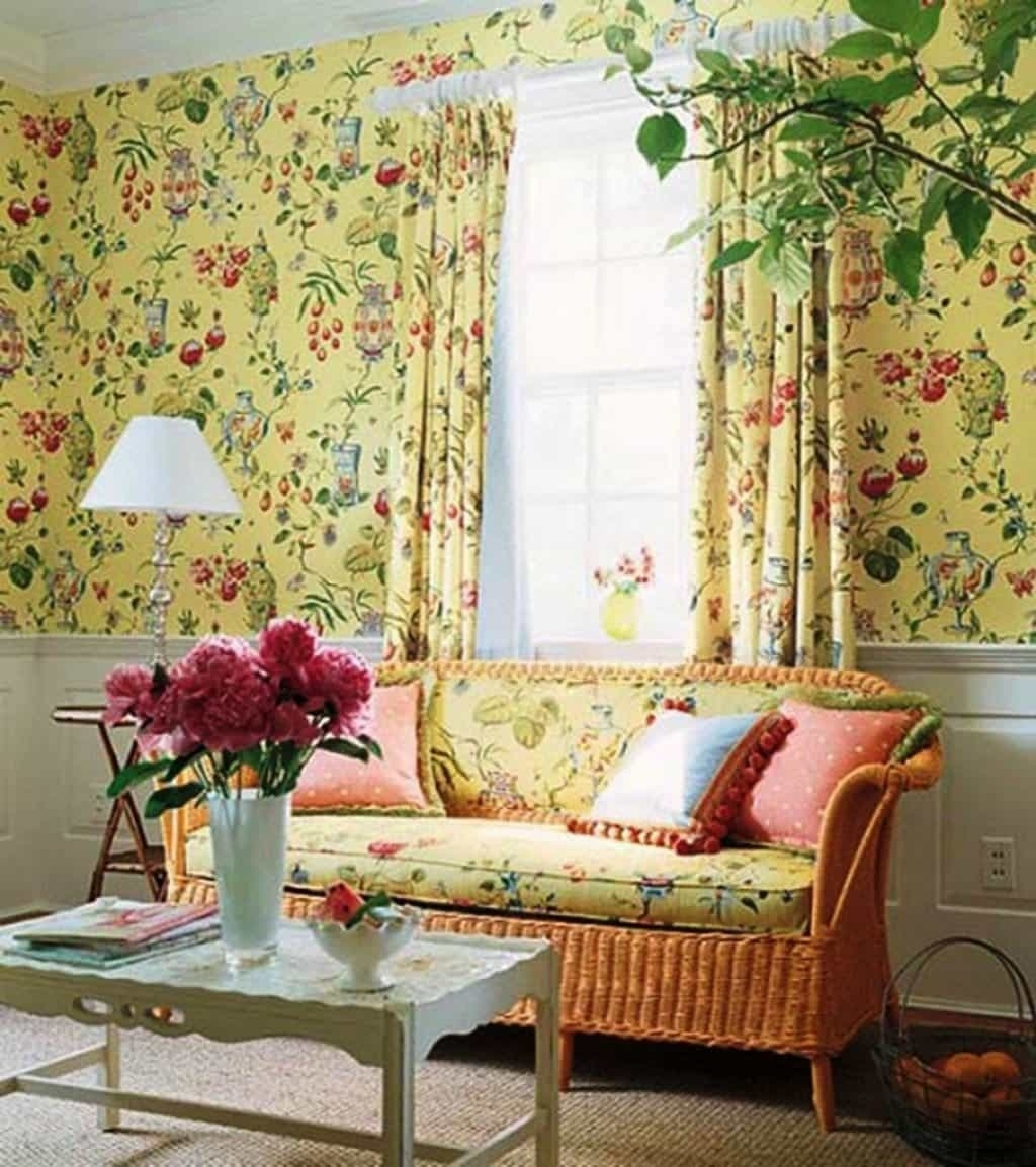 country style living room with wicker sofa and floral wallpaper throughout French Country Wallpaper