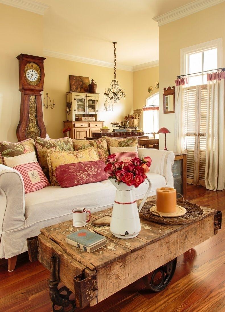 french country. warm colors, wood, white couch | decor | living room with regard to Colorful and Inviting French Country Decor