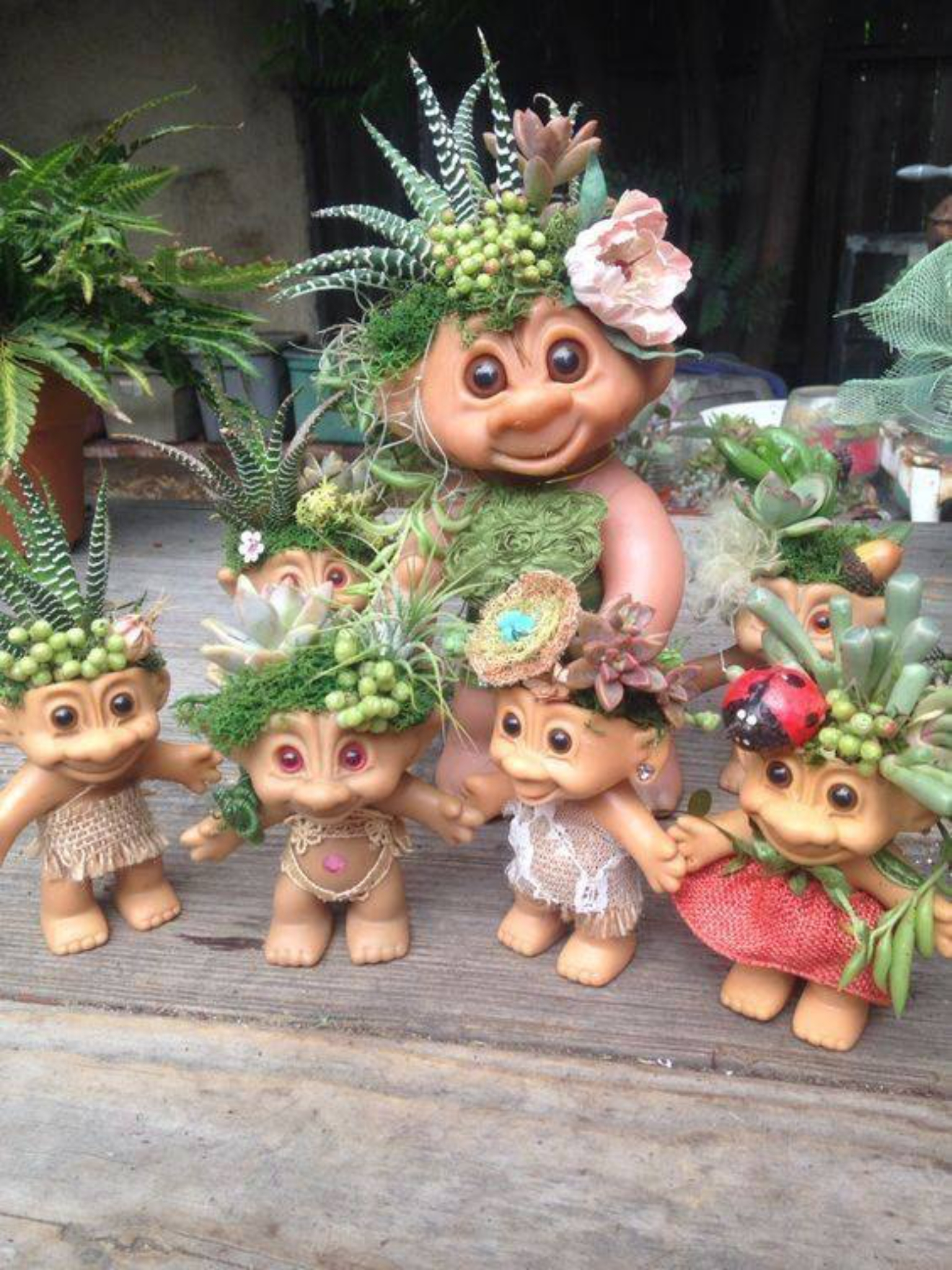 troll dolls upcycled succulent holder | cactus garden inspiration for Decorating The Garden