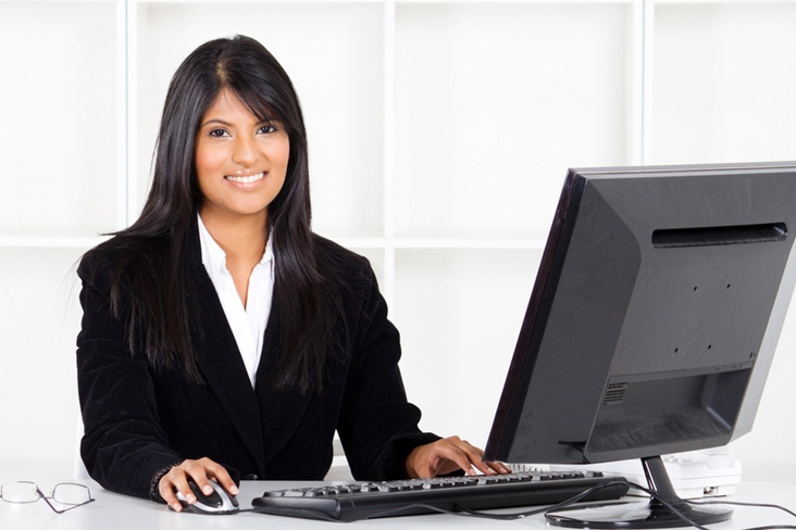 attractive latin american businesswoman working in office
