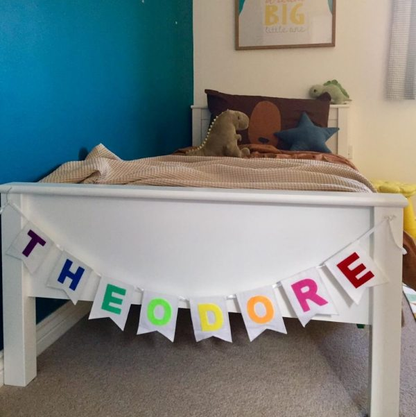 Felt personalised nursery bunting for playroom in rainbow colours