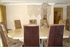Stone International bespoke table with leather chairs at Marie Charnley Interiors