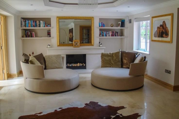 B&B Italia Max Alto Amoenus swivel chairs in gold at Marie Charnley Interiors