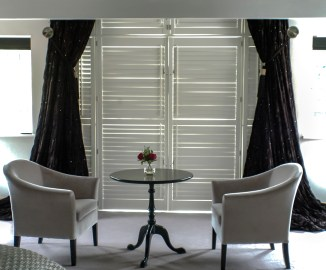 Two Silver velvet Belgravia tub chairs at Marie Charnley Interiors