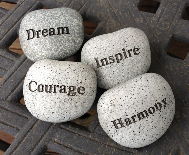 "Four stones with the words ""dream"" ""courage"", ""inspire"", and ""harmony"" on article about planning your life before you plan to get a job on mariedeveaux.com"