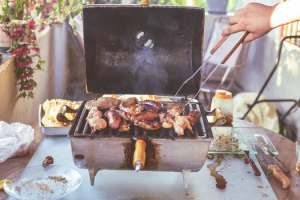 image of meat turning meat on grill to explain the labor day holiday and wht it means to workers on mariedeveaux.com career coach site on career advice