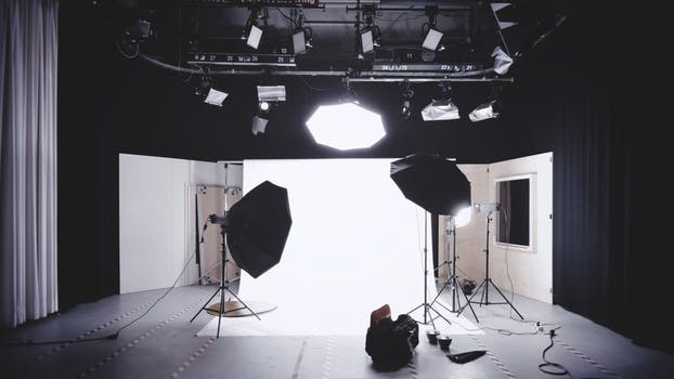 Picture of a photo shoot set with umbrella lights and a huge bright backdrop as reference to Marie Deveaux Career Coach September giveaway on Instagram Live