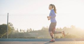 Image of woman running at daybreak as Marie Deveaux career coach explains the power of moving meditations