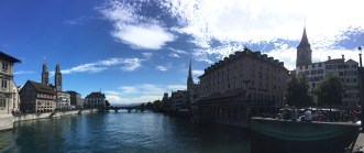 Panoramic view of the Limmat river, with Grossmünster and Fraumünster on each side
