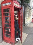 Posing at a telephone box