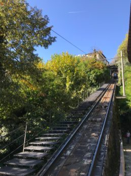 Taking the cable car to go up Mount Madonna del Sasso