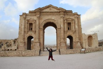 Jumping in front of the Arch of Adrian